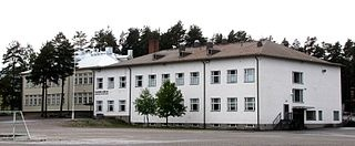 Sanssi's School, Kauhajoki, Finland.   During the Winter War between 1939–1940, Kauhajoki hosted the Finnish parliament. (The wooden building on the left.)