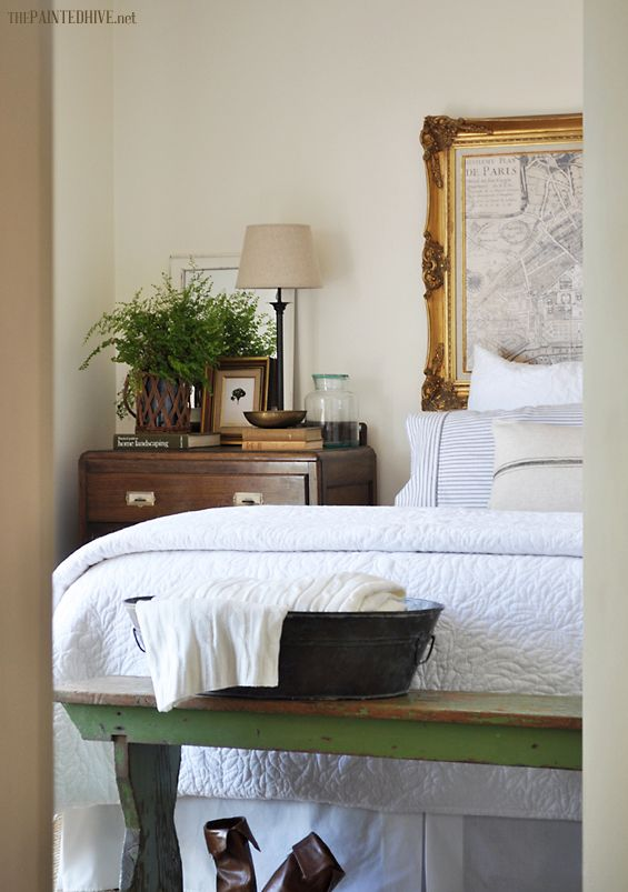 Every bedroom should have a plant (and a lamp, books, frames and vintage bench seat)