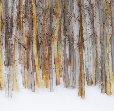 Michelle Mckinney, Winter Trees.  Michelle McKinney works with hand cut translucent woven stainless steel, copper and brass to create wall sculptures and framed pieces that are at once simple and complex; abstract and realistic.