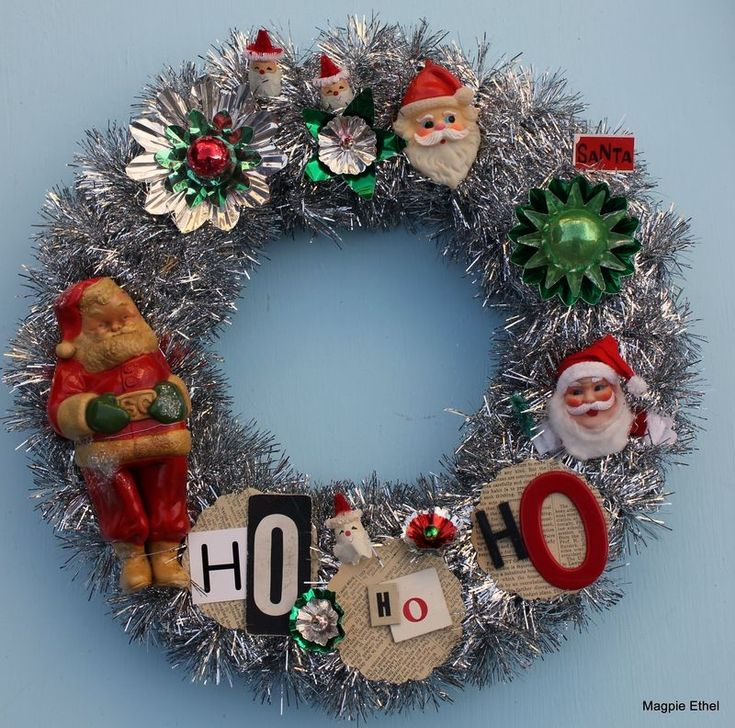 Wreath wrapped with tinsel adorned with vintage