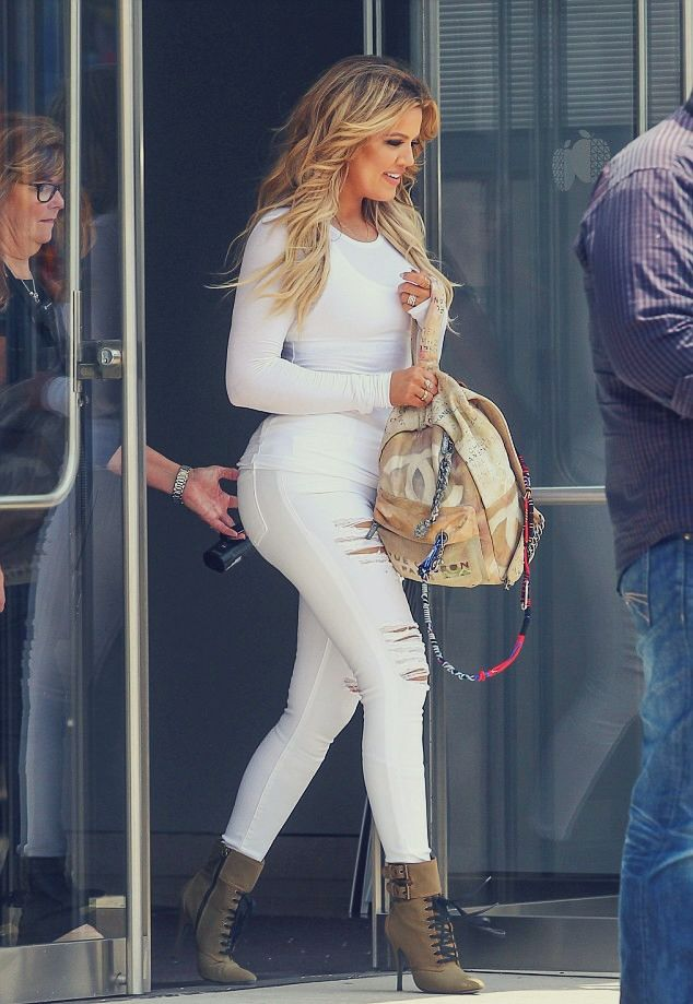 KHLOE KARDASHIAN I told the hubby distressed white jeans were a need not a want...lol