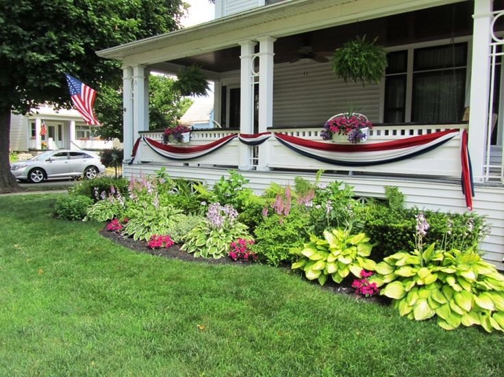 Simple front yard landscaping with flowers for ranch style for Colorful front yard garden plans