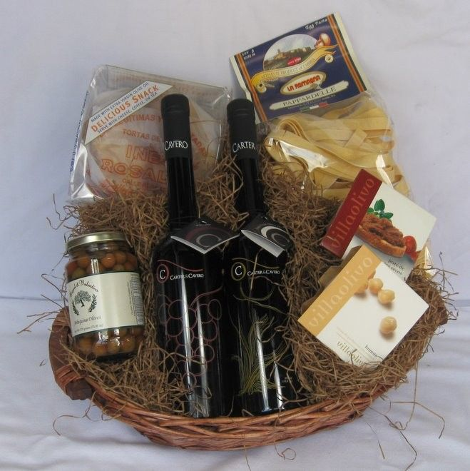 Mediterranean Basket - This basket includes a 500 ml. bottle of our Spanish Hojiblanca Extra-Virgin Olive Oil, a 500 ml. bottle of our Traditional Balsamic Vinegar from Italy, a 1 lb. package of Italian Pasta, a 4.4 oz. package of Spanish black olive tapenade, a 4.4 oz. package of sun dried tomato spread, a 6 oz. package of olive oil tortas from Spain and a 10.2 oz. jar of olives. All of this presented to perfection in one of our gift baskets.