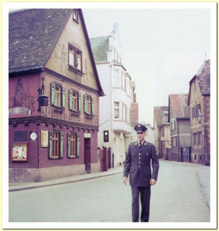 Nauheim -Just around the corner of the Burgpforte, in the Burgstrasse, is the restaurant (Gasthaus Zur Krone) that Elvis is passing here. Presley is walking in the direction of the Borgforte, so one can assume this photo was taken a bit earlier. This pic is scanned from the book: Like Any Other Soldier