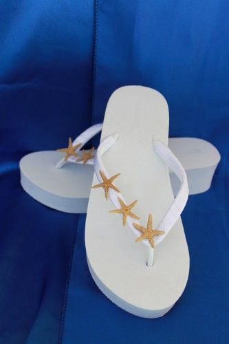 These amazing Bridal Wedge White Flip Flops are adorned with REAL STARFISH!  The straps are wrapped in white satin ribbon and then adorned with real starfish (slight color/size variation may occur due