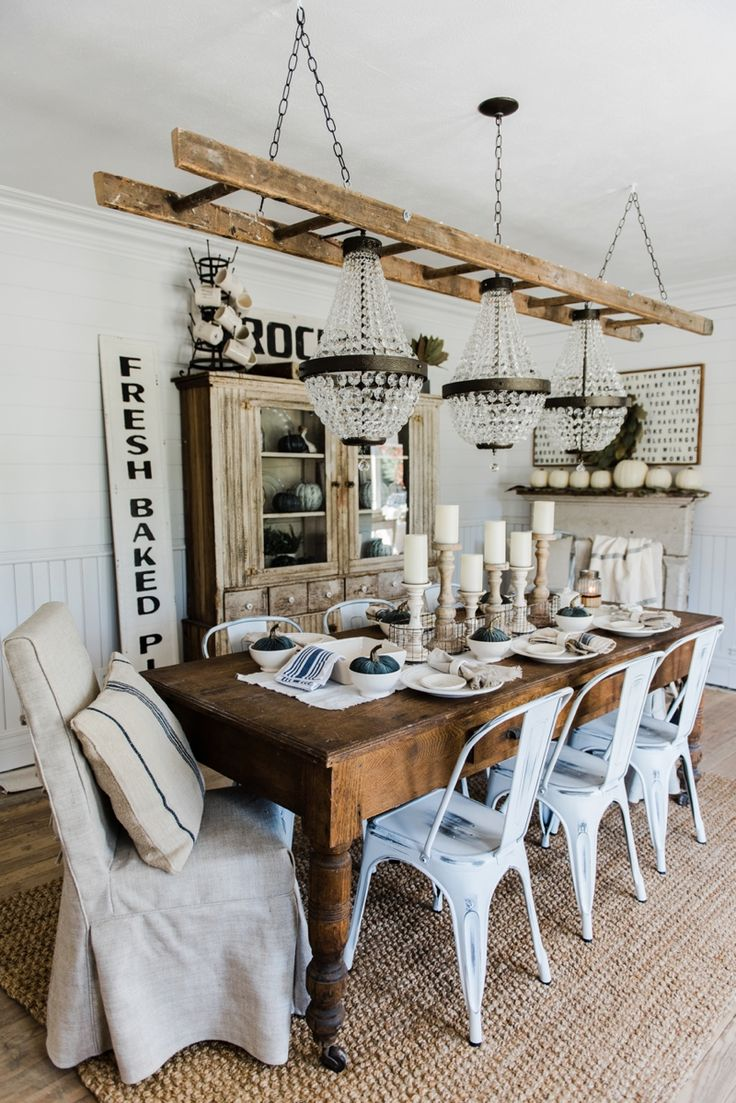 Three chandeliers + a ladder. Pretty farmhouse dining room