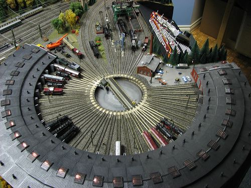 With plenty of space and plenty of rolling stock a Roundhouse and Turntable would be ideal
