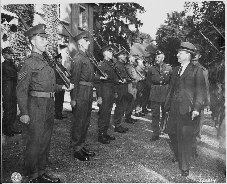 British Prime Minister, Clement Attlee inspects the honor guard, consisting of Scots Guards