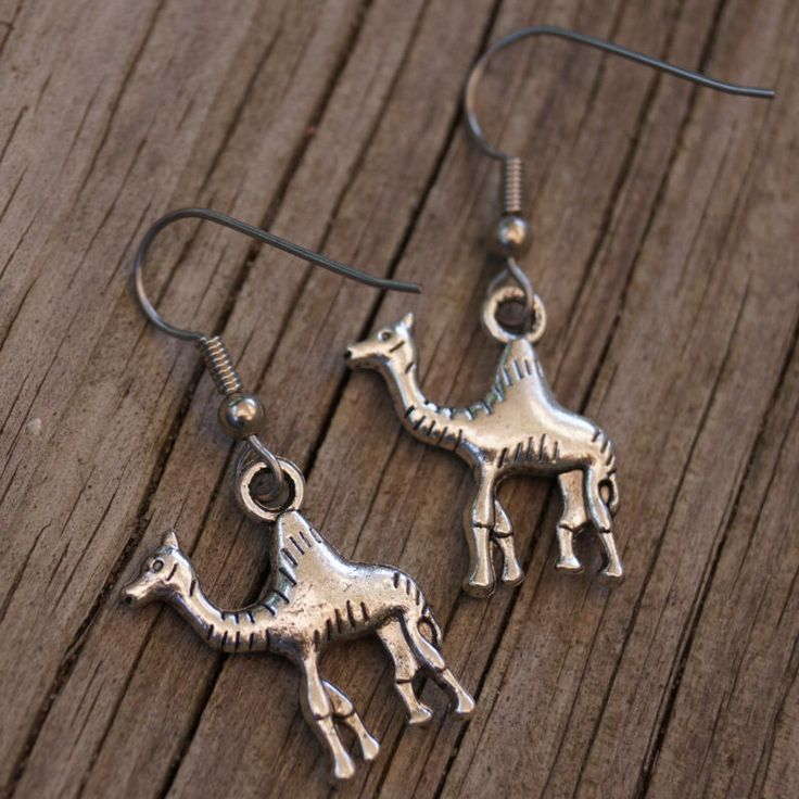 Hump day earrings, camel earrings, small fun silver charm earrings   https://www.etsy.com/listing/241911285/camel-earrings-hump-day-earrings-hump
