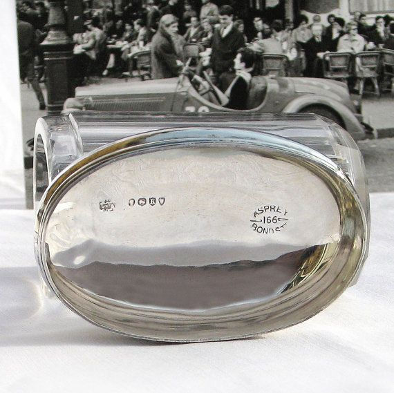 Antique Asprey Silver: A pretty sterling silver and cut glass, faceted oval dressing table jar that was once part of a gentleman's dressing table set. The silver lid (push cap) fits smoothly and clearly shows the hallmarks inside, including the Asprey backstamp for 166 Bond Street. Dates to c.1885.