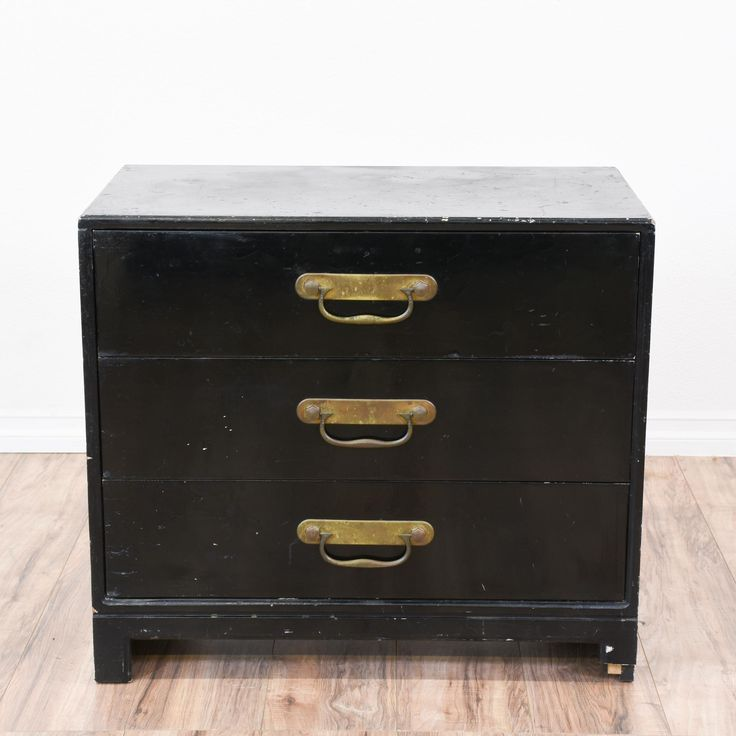 This Asian inspired chest of drawers is featured in a solid wood painted in a distressed black finish. This small dresser has some wear but is otherwise in great condition with 3 drawers, a raised base and brass hardware. Unique oriental storage piece! #asian #dressers #shortdresser #sandiegovintage #vintagefurniture