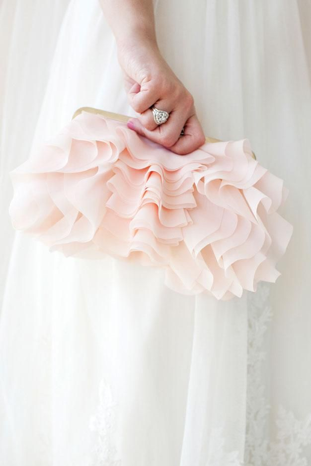 How gorgeous is this blush pink ruffled clutch? We must have one! Photo by Perez Photography #wedding #bridal #accessories