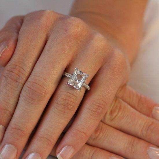 emerald cut diamond. Set with simple prongs on a diamond band