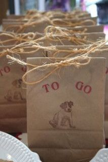 "To-go bags for a dog party, but use ""doggy bags"" instead"