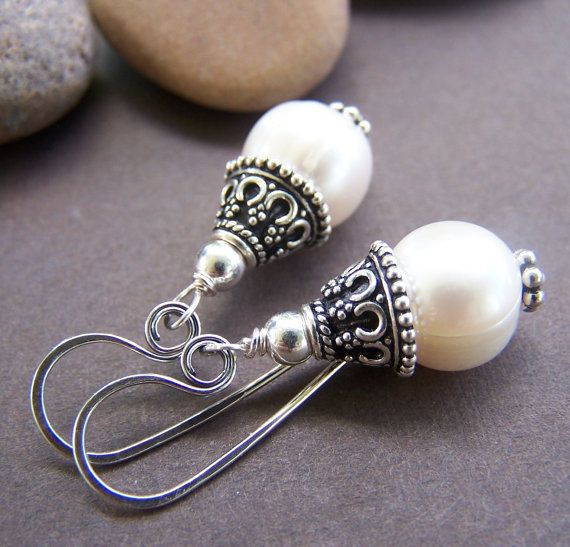 I hand chose these large freshwater pearls for these elegant earrings. The pearls are topped with intricately detailed sterling silver bead