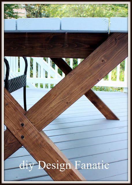 Pottery Barn Inspired Picnic Table ... the legs are stained with Behr Cordovan Brown transparent deck stain from Home Depot.