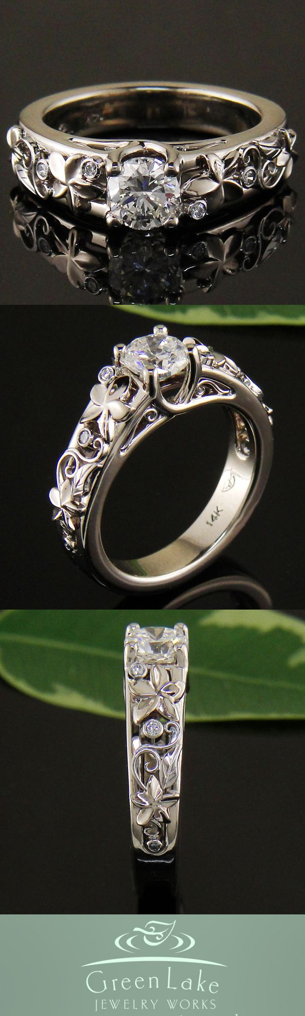 Custom 14k white gold plumeria ring with diamond center stone.