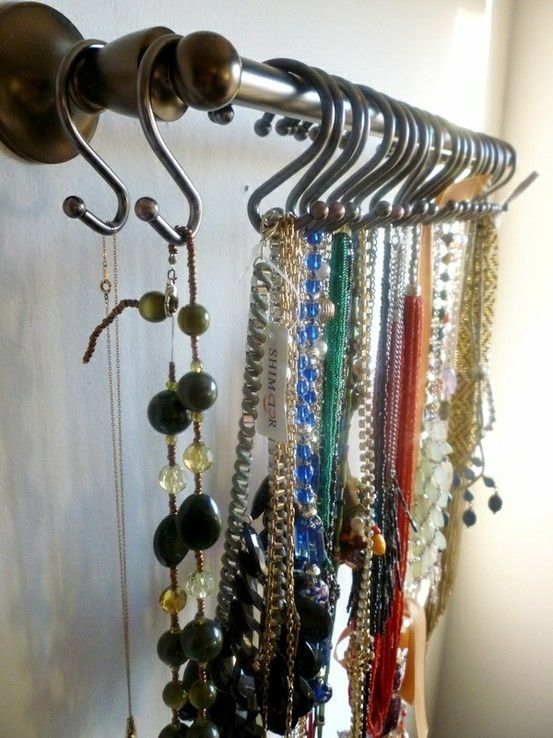 Necklace, Bracelet & Belt Storage.  Install a curtain rod and shower curtain hooks on a wall on the inside of a closet door.  Perfect for storing necklaces, bracelet sets and belts.  Keeps your jewelry right at your fingertips.  No more tangled chains, digging through piles of bracelets or pulling off 6 belts to get the one you want.  Best of all....it can be expanded as needed!!