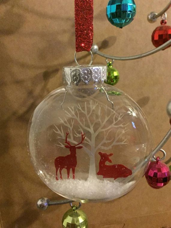 This snowglobe like ornament is the perfect addition for your tree, holiday decor and makes a great little gift. size about 3×3  Materials: glass ornament, faux snow, vinyl and transparency.