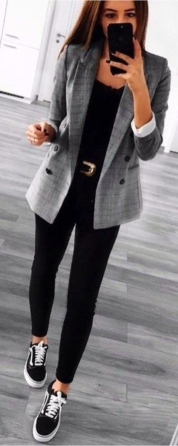 woman in black pants and gray blazer taking selfie. Pic by @find_my_style
