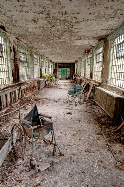 """""""Only former patient wheelchairs remain in this corridor connecting patient wards to the admin sections."""""""