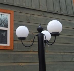 A solar powered DIY street light! Made from three solar powered stick lights from Walmart, an old chandelier, pvc pipe, and lots of spraypaint. Too cool.