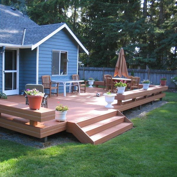In lieu of railings, benches surround this composite deck. They not only provide plenty of seating, but also create an open environment to easily enjoy the yard beyond.