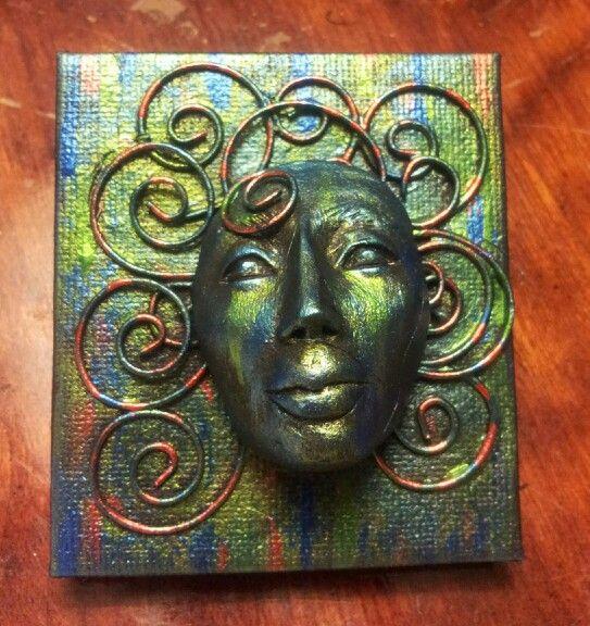 Face multimedia sculpture
