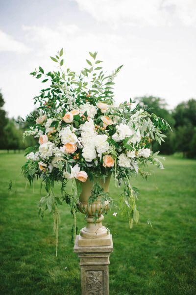 Elegant florals: http://www.stylemepretty.com/little-black-book-blog/2015/03/31/elegant-summer-estate-wedding/   Photography: Michelle Gardella - http://www.michellegardella.com/