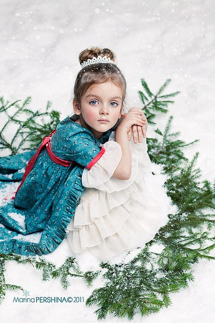 The lighting and styling are perfect in this photo.  A great holiday portrait.