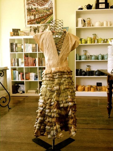 """High Tea"" is a dress made of 650 recycled teabags, created by local artist Talia Blyer of Hamilton, MA. This outstanding piece is currently on display in our storefront."