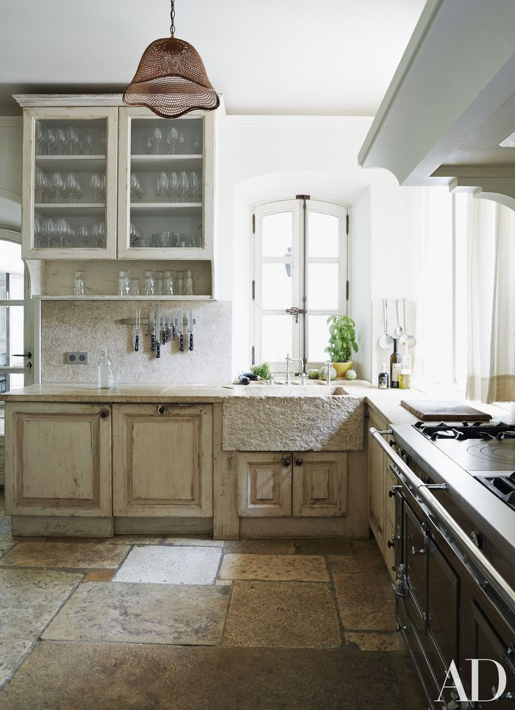 European kitchen in Frédéric Fekkai's Vacation Home in  South France - that textured farmhouse apron sink.