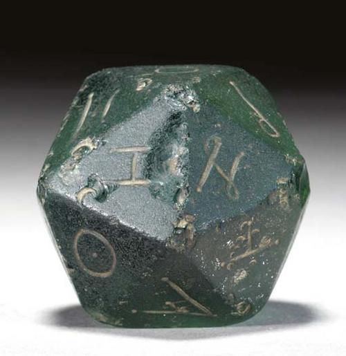 Game dice.  The dice for the Royal Game of Ur wasn't found, but this is probably the kind of dice that was used.