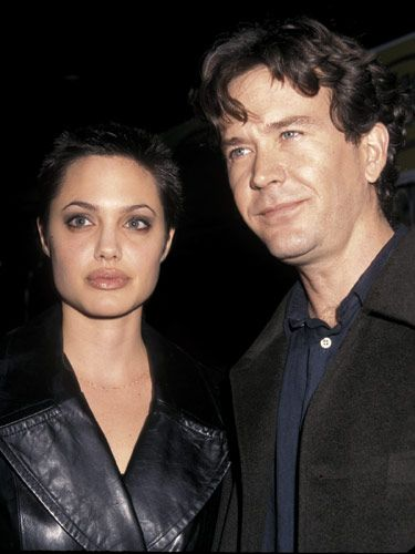 "Angelina Jolie with then bf Timothy Hutton (1997) >> ""When she & Timothy broke up, Angie took it hard, the source says. 'Angie was very in love with Timothy & wanted to get serious, but he didn't,"" says the insider. 'He broke her heart, & that led to a downward spiral for her in terms of her mental health.' The insider adds that after the split, Angie turned to women and experimented with heroin."" (Cele 