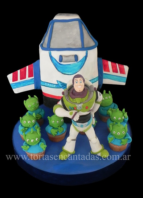 Buzz Lightyear's Space Shuttle Cake with adorable cupcakes   By Tortas Encantadas    Torta de Buzz Lightyear, via Flickr.  The cake is Buzz's shuttle; Buzz is made out of gumpaste (sugar!).