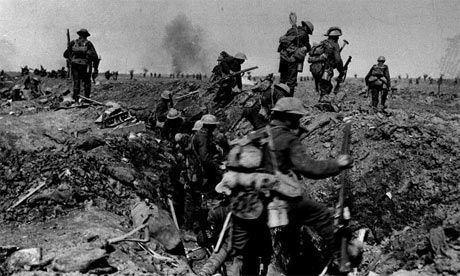British troops negotiate a trench as they go forward in support of an attack on the village of Morval during the Battle of the Somme. Photog...
