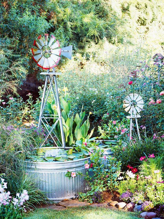 Galvanized stock tanks, which typically hold water for livestock, are perfect for an easy-to-build water feature. Ornamental windmills spin in the breeze, complementing the farm feel of the tanks.