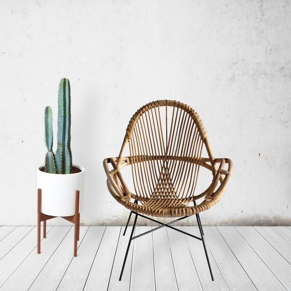 A comfortable, low lounge chair, our Shasta Lounger is made from sturdy pole rattan. It has been woven with contrasting color peel rattan on a bent iron rod frame and completed with a beautiful natura