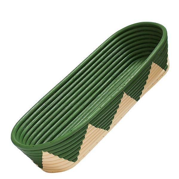 oblong rattan bowl with hand painted green inside and green triangles on outside