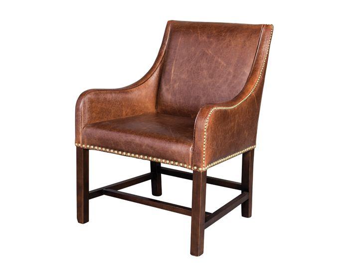 Необычное, стильное кресло на высоких ножках. Кожаная обивка кресла декорирована гвоздиками с широкой шляпкой.             Материал: Дерево, Кожа натуральная.              Бренд: Restoration Concept.              Стили: Лофт.              Цвета: Коричневый.