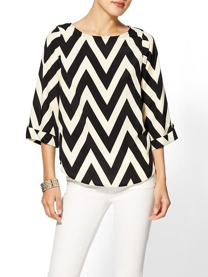 Strong lines make for a bold and graphic blouse. #style