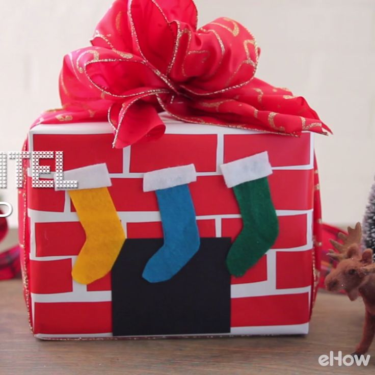 Capture the warmth of a fireplace at Christmas with this whimsical wrapping.