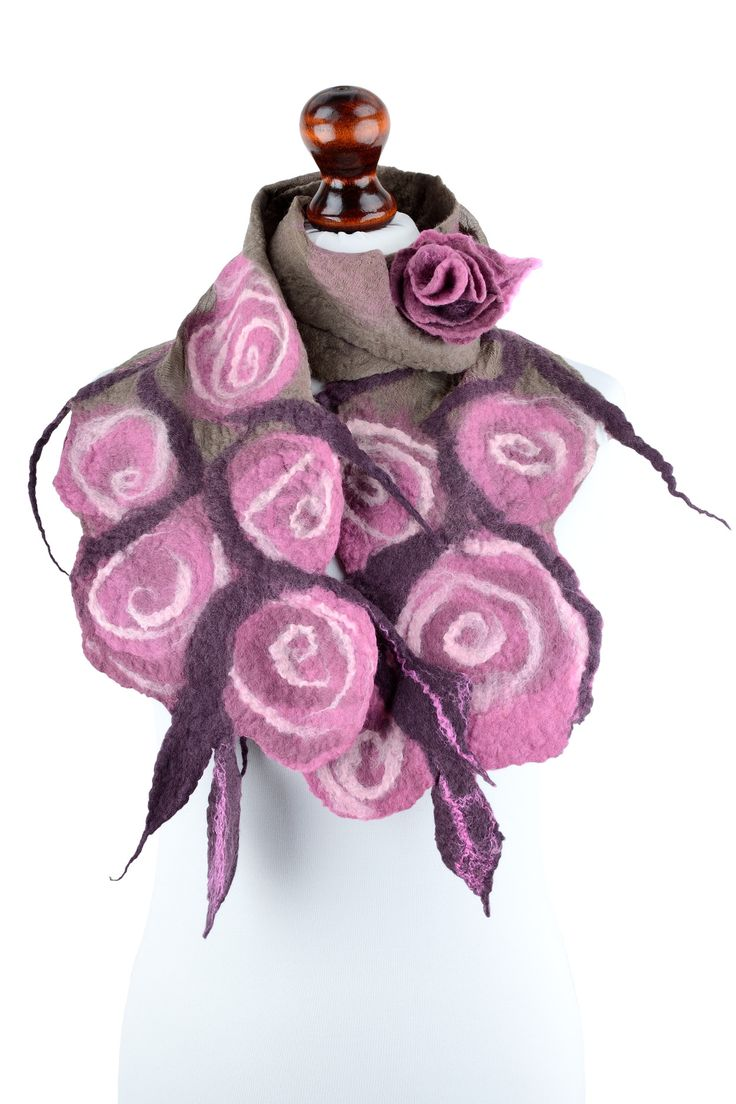 This nuno felt rose scarf is designed for women, who love romantic and retro style. It is very feminine and comes as a set with a small rose brooch!