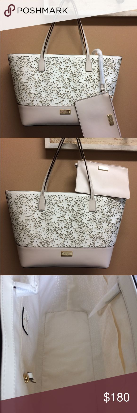 "NWT Kate Spade Shoulder bag NWT Kate Spade Shoulder bag. Cream cowhide leather with 14K gold plated hardware.  Includes 5"" x 7"" zip pouch. open top with dog leash closure. Approx. measurements 18"" h (with handles) x 17 x 6""D. 11 1/2"" bottom kate spade Bags Shoulder Bags"