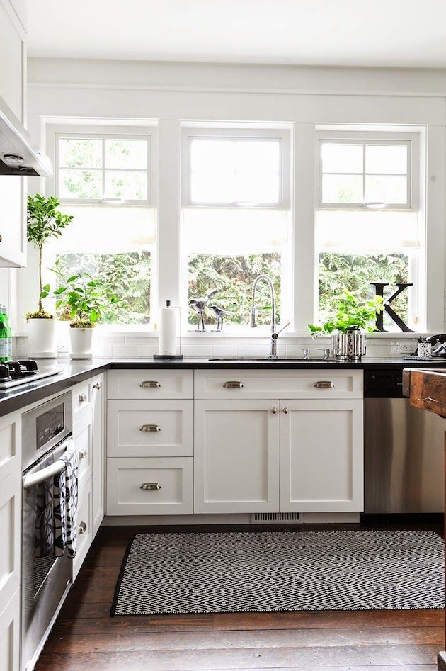Dream Kitchen, Light, bright, big window White cabinets, black counters and  dark wood floors