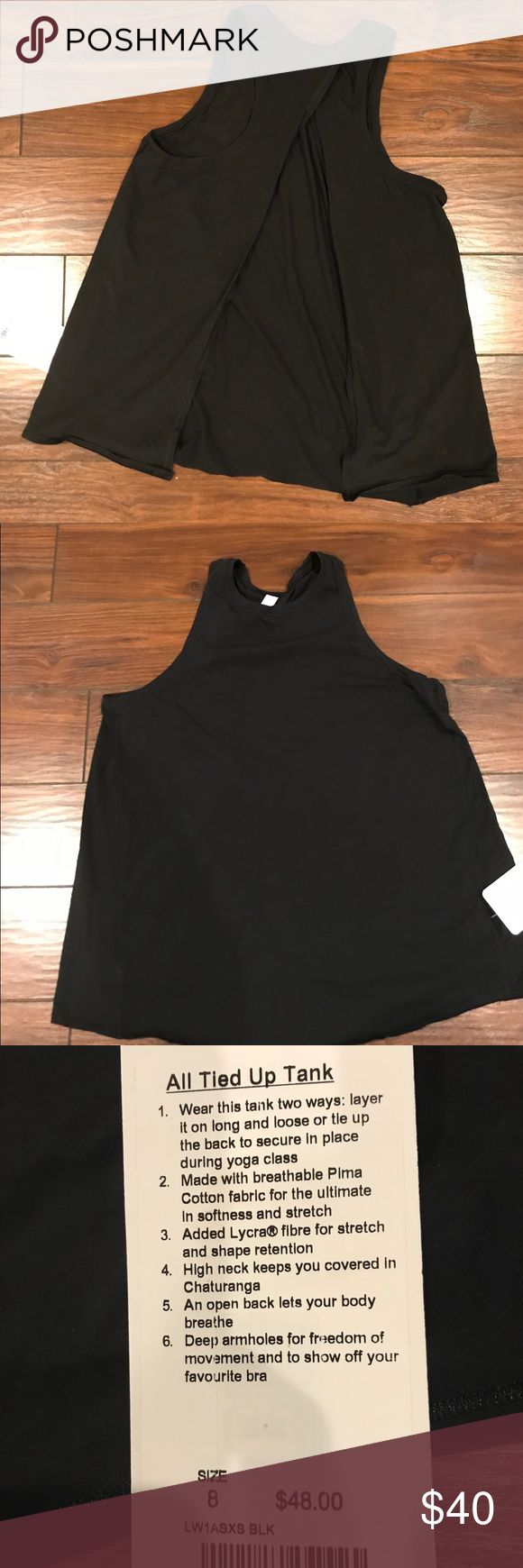 Lululemon All Tied Up Tank This tank allows to be worn two ways: layer it on long and loose or tie up the back to secure. Small stitching coming loose lululemon athletica Tops Tank Tops