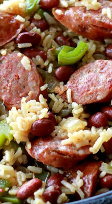 This quick and easy Red Beans and Rice is ready in less than an hour and has all the great flavor of the slow cooked variety.  The best part is it's all done in one pot!