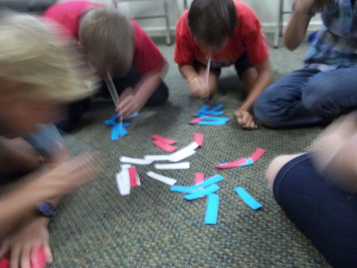 """I'm calling it """"Vacuum Verses"""" - adapted from a game in the Alabama Baptist Convention youth Bible drill ideas book.  The photo is blurry because the kids are frantically trying to be the first to suck up all of the parts to the Bible verse and put them in order.  :)"""