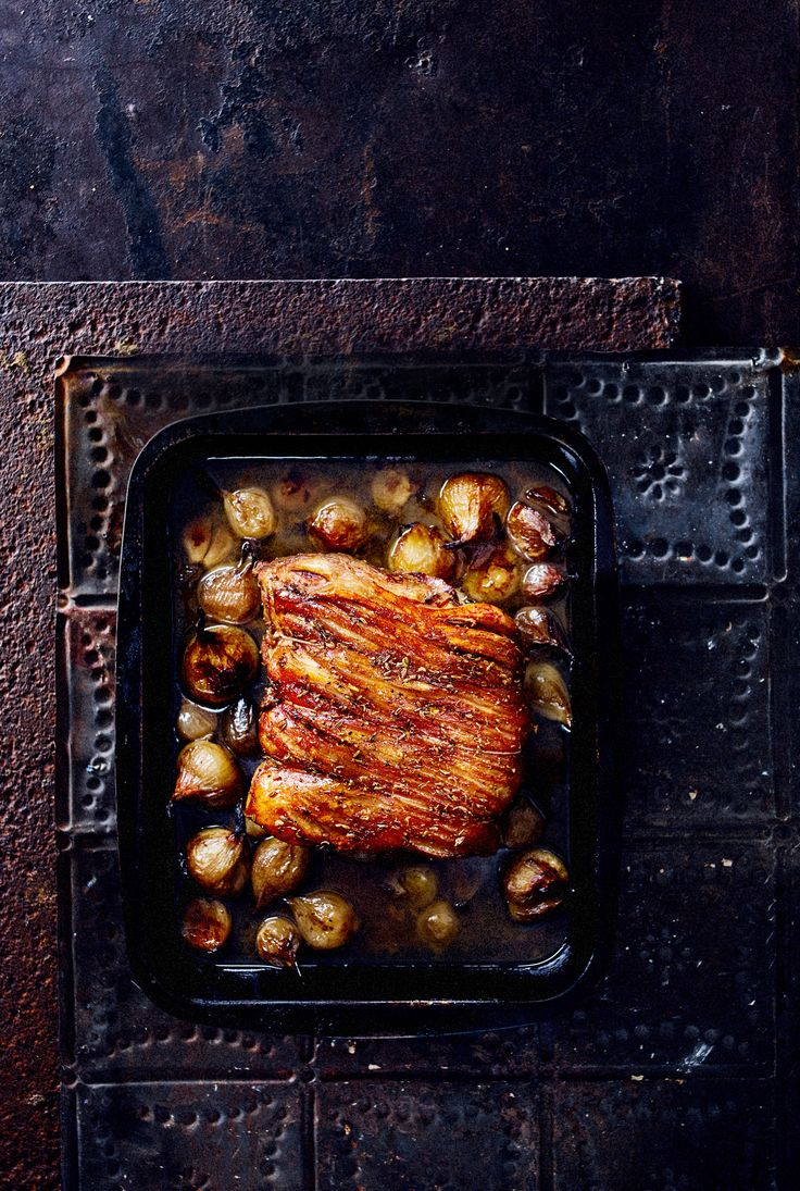 Slow roast pork recipe with fennel seeds and round shallots. Perfect for a Sunday roast dinner with family and friends