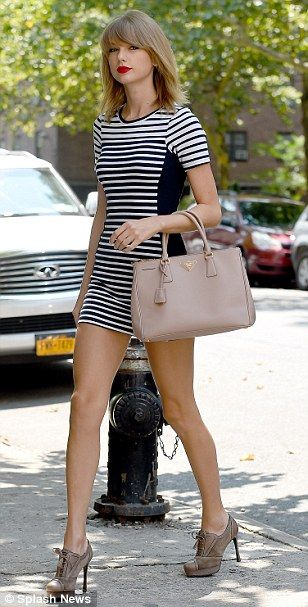 Taylor Swift (with a Prada bag) - In New York.  (July 2014)